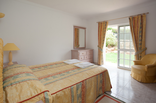 Photo of a bedroom in one of our detached villas